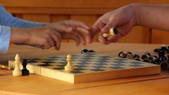 Father and son are arranged on a chessboard chess Stock Footage