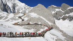 Tourists climbing up to the top of Jade Dragon Snow Mountain Stock Footage
