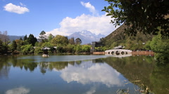 Beautiful view of Black Dragon Pool with Jade dragon snow mountain Stock Footage