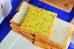 Bread and butter in soft light - stock photo
