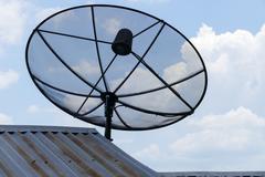 satellite dish on the galvanized roof - stock photo