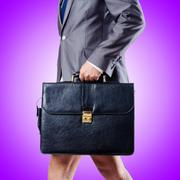 Nude businessman with briefcase against gradient Stock Photos