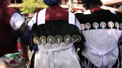 Naxi women performing traditional national dance on central square of Lijiang Stock Footage