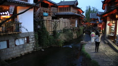 Tourists taking photos in old town of Lijiang Stock Footage