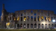 Piazza Del Colosseo Rome Colosseum Amphitheater Tourists Nightfall Police Lights - stock footage