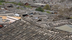 Beautiful traditional tiled rooves in old town of Lijiang Stock Footage