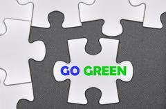jigsaw puzzle written word go green - stock photo