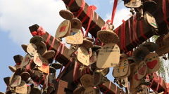 Wooden wishing bells hanging at Shuhe old town in Lijiang Stock Footage