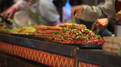 Traditional panbroiled food in old town of Lijiang Stock Footage