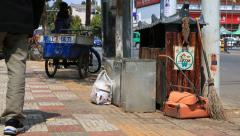Traditional trash bin on the street around the old town of Lijiang Stock Footage