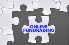 jigsaw puzzle written word online fundraising - stock photo