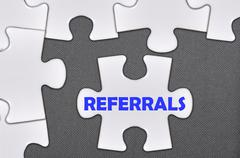 jigsaw puzzle written word referrals - stock photo