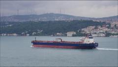 TURKEY Istanbul June 2015: A large Cargo ship sails through the Bosporus Strait Stock Footage
