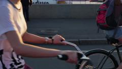 MOSCOW, GORKY PARK, CIRCA 2015: Two hipster girls passing on bicycles on city st Stock Footage