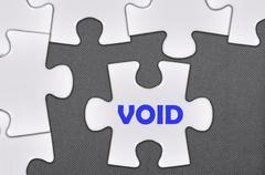 jigsaw puzzle written word void - stock photo