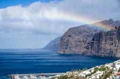 Rainbow over Los Gigantes cliffs and resorts, Tenerife Stock Photos