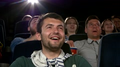Young man watching movie at cinema: comedy. Close up Stock Footage