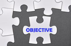 Jigsaw puzzle written word objective Stock Photos