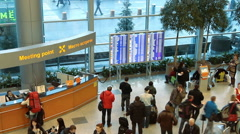 People near information board inside arrival hall in airport Domodedovo. Stock Footage