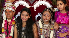 Stock Video Footage of Traditional Indian wedding. Relatives photographed with the bride and groom.