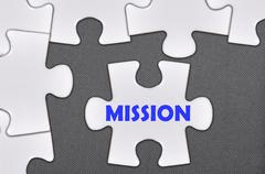 Jigsaw puzzle written word mission Stock Photos