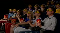Stock Video Footage of Young people watch movies in cinema:  comedy in 3D