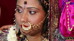 Traditional Indian wedding. Face of the bride is adorned with lots of jewelry. Stock Footage
