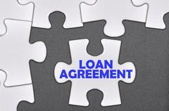 jigsaw puzzle written word loan agreement - stock photo