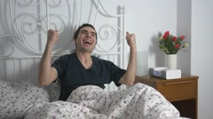 4K Happy Celebrates Man In the Morning In Bed Stock Footage
