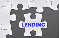 jigsaw puzzle written word lending - stock photo