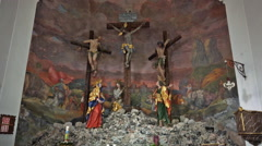 Jesus crucifixion figures in mountain church Hallstatt Stock Footage