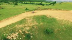 Dirt Bikes Riding Off-Road Extreme Sports Jump Danger Aerial Shot Stock Footage