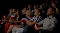 Cinema, entertainment and people - happy friends watching movie in theater Stock Footage