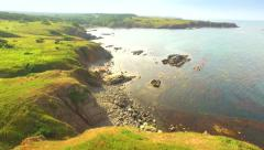 Paradise Island Aerial Fly Over Cliffs Rocks Ocean High Altitude Green Grass Stock Footage