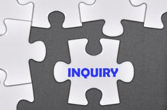 Jigsaw puzzle written word inquiry Stock Photos