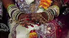 Traditional Indian wedding. The bride is adorned with lots of jewelry and henna. Stock Footage