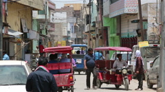 A Lot of rickshaws and motorcycles on an old Indian street Stock Footage
