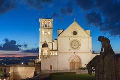 The Papal Basilica of St. Francis of Assisi after sunset - stock photo