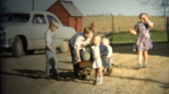 (8mm Vintage) 1952 Farm Kids Pulling Wagon. Iowa, USA. Stock Footage