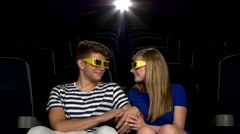 Young couple watching a film at the cinema, 3D glasses Stock Footage