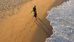 Aerial Young Surfers Walking On Sandy Beach Searching For Waves Sunset Couple Stock Footage