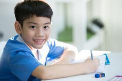 Young asian boy doing his homework Stock Photos