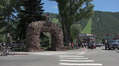 Jackson Hole Wyoming Elk Arch main city street traffic 4K Stock Footage