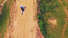Motorcyclist Off-Road Dirt Bike Jumping Slow Motion Aerial Extreme Sports Stock Footage
