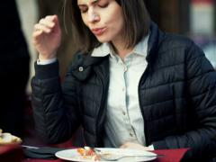 Woman gets stomach ache during lunch in cafe NTSC Stock Footage