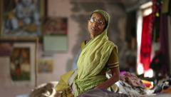 An elderly Indian woman in a dormitory at the Ashram. Stock Footage