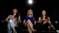 Cute girl watching movie in cinema theater. exciting moment Arkistovideo