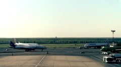 The plane is taxiing to the gate Stock Footage