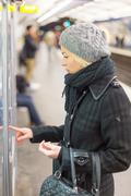 Lady buying ticket for public transport. - stock photo