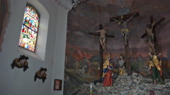 Crucifixion figures pan mountain church Hallstatt Stock Footage